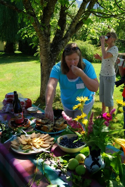 A picnic is spread out in the shade during a bright summer morningCredit: Bellingham Whatcom County Tourism