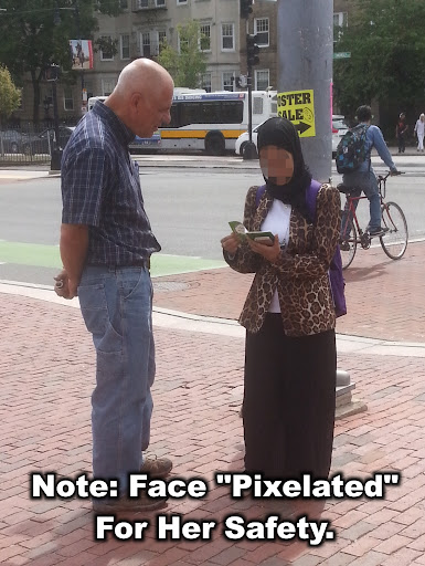 """We're seeing the Muslim population increase in Boston. But that just means that God is sending the Mission Field to us! Here, Eric is sharing Christ with a Muslim woman. He gave her a copy of """"The Gospel of Luke"""" in Arabic. Sadly, she looked it over and handed it back to him. Please pray that God waters that seed and we'll see many turn away from Islam and turn to the Lord Jesus Christ!"""