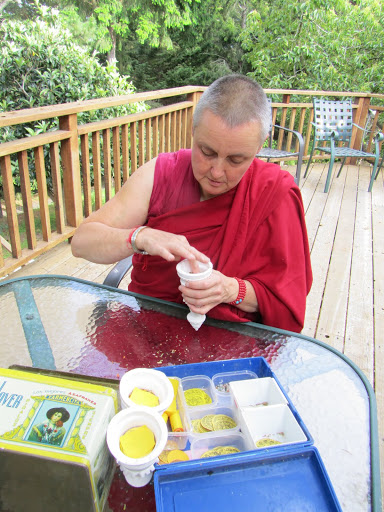 Ven. Anet creating kadampa stupas at Lama Zopa Rinpoche's house. Photo by Whitney Dafoe.