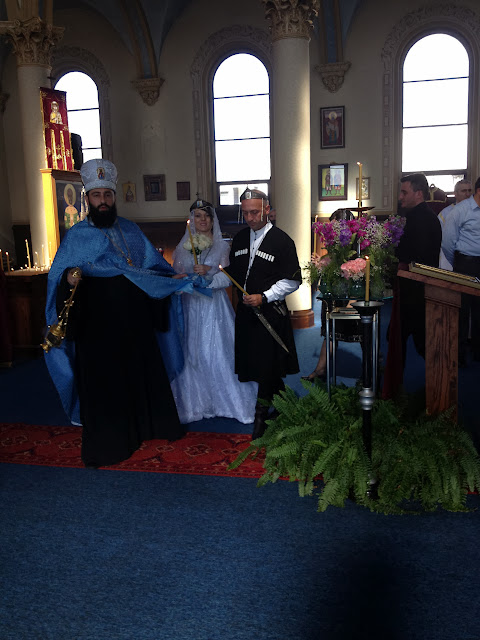Keti and Lasha are led by Fr. Matata during the 'Dance of Isaiah'