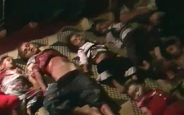 A picture taken on August 16, 2015 shows dead bodies lined ... |Dead Syrians