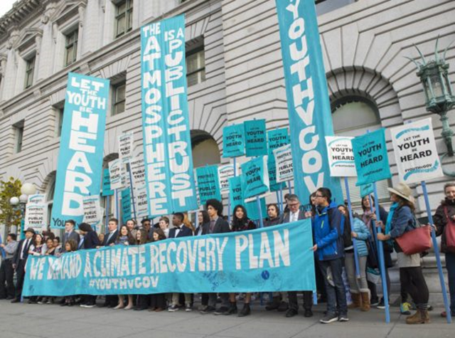 Young people deomnstrate is support of the landmark youth-led climate lawsuit, 'Juliana v. United States'. The case has survived numerous Trump administration appeals to stop it from advancing to trial. Photo: Robin Loznak