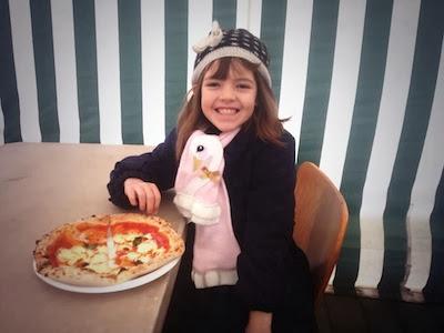 Enjoying an Honest Crust pizza.