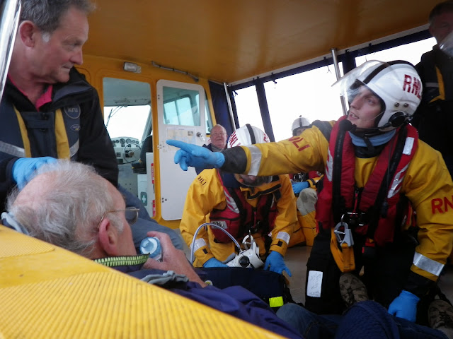 Crew Member Rob Inett asking questions to gain a medical history in a training exercise - 22 April 2014 Photo: RNLI Poole/Anne Millman