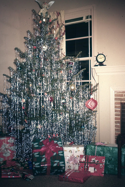 i think if you did not have a shiny aluminum christmas tree you loaded it down with tinsel - Mid Century Christmas Tree