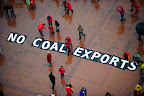 Protesters gathered in Portland's Pioneer Courthouse Square to call on Governor Kitzhaber to oppose coal exports in Oregon and the Pacific Northwest. (Photo by: Alex Milan Tracy)