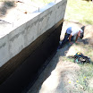 Installaiton of DrainGuard to collect water and drain it to the footing drains.