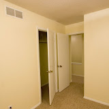 Looking out the northwest bedroom.  Closet door is on the left.  Upstairs landing is behind the door on the right.