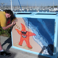 Zach Illig helping to paint on Kyle Garden's artwork, another finalist at Ventura Harbor HS Competition 2009.