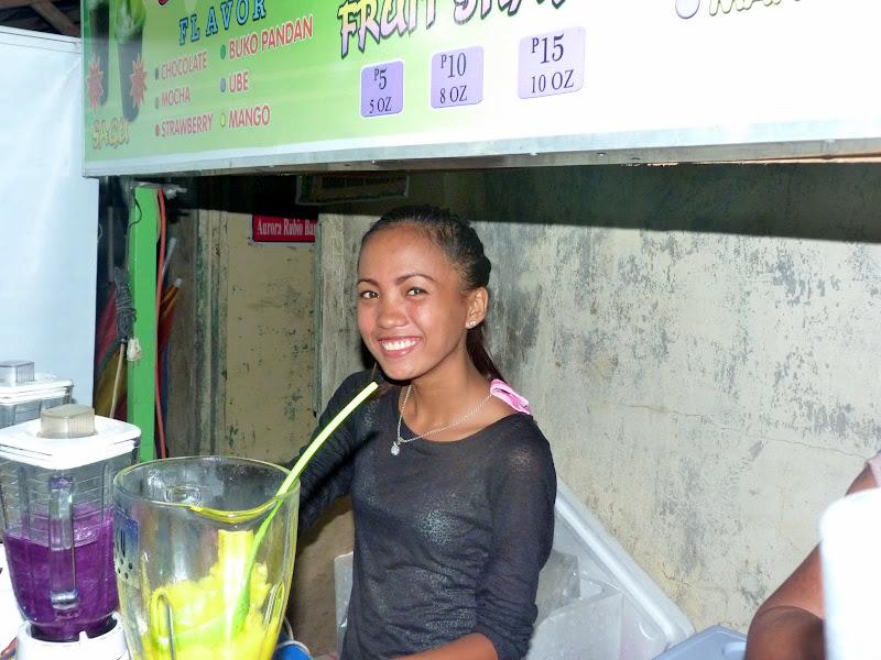 Vendeuse de jus de mangue