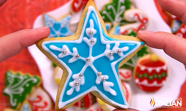 holding sugar cookie decorated