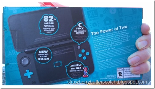 The back side of the Nintendo 2 DS XL box.