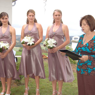 Teresa's bridesmaids - mocha mirror satin halter-neck gowns with bias skirts