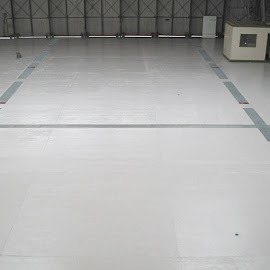 Aircraft Hangar Floor. The old paint system on this floor was completely removed by Ultra High Pressure Water Jetting. The floor, some 2200 metre squares, was then painted with 3 coats of  High Build Epoxy.