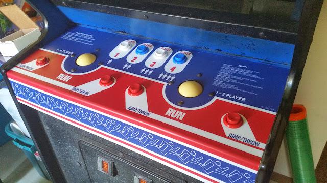 track and field arcade machine