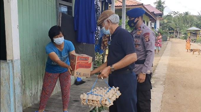 Penyaluran Infaq 2000 Kepada Masyarakat, Brimob Kaltim Sambang RT.14 Teluk Bayur Berau