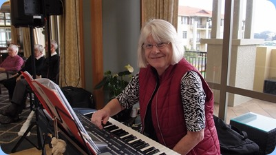 Mary Barrett playing her Korg Pa800.