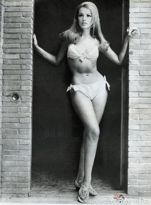 Magda Konopka white bikini standing in doorway