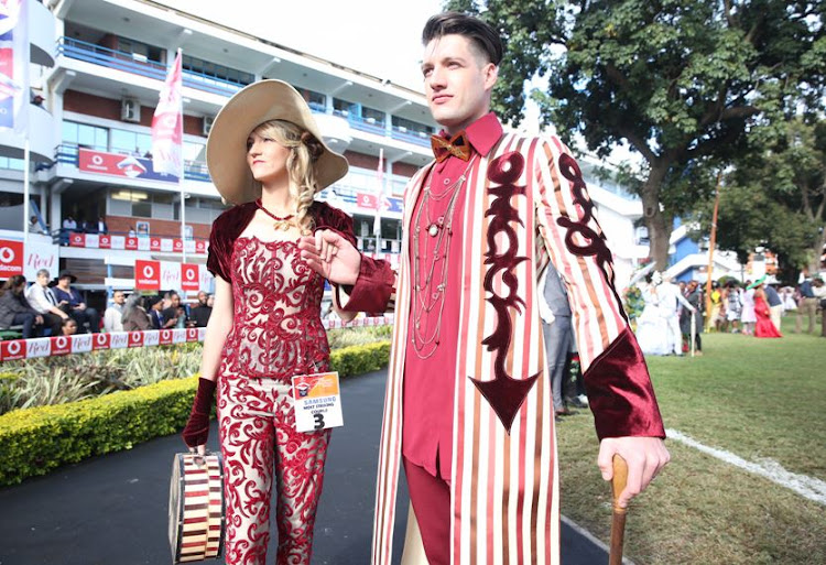 Leandi and Wayne Redgard wear designers by Brenda Warring at the Durban July.