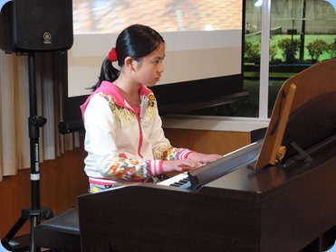 New member, Phoebe Zhang, played two classical pieces for us on our Clavinova CVP-509. this was Phoebe's debut at the Club. Phoebe is just 10 years of age but playing wonderfully! Photo courtesy of Dennis Lyons.