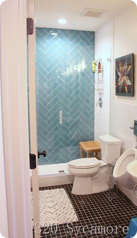 blue herringbone tile shower