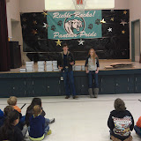 Cardinal Newman Interact members Paige Amormino, CN '15 and Josh Gluch, CN '13 delivering dictionaries to third graders at Riebli School.