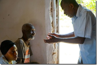 pastor sharing the gospel with the father