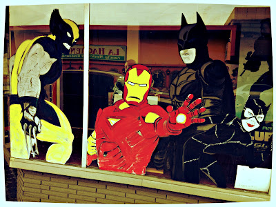 Front window display of super heroes at The Comic Den, downtown Renton, Washington.