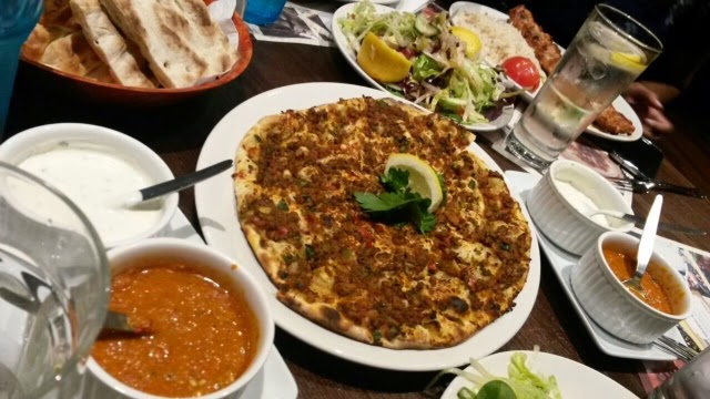 Turkish pizza topped with mince, known as lahmacum