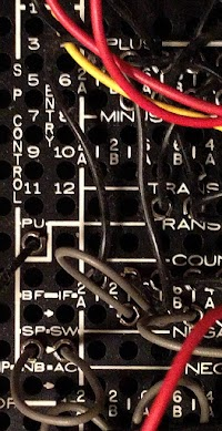 Summary punch wiring on the IBM 403 plugboard.  The summary punch control pickup (SP Control PU on the left) is wired to punch a summary card on a minor total.  The summary punch switch (SP.SW) hubs are connected by the gray wire (lower left).