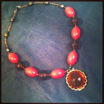 handmade costume jewelry statement necklace with vintage amber color beads and pink matte beads