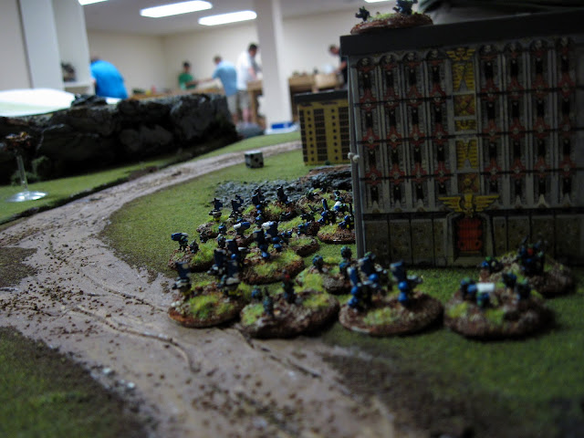 Orks holding down a building.