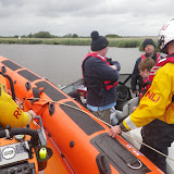 8 June 2012: ILB crew speak to the crew of a grounded speedboat in Wareham Channel. Photo: RNLI/Mark Ponchaud