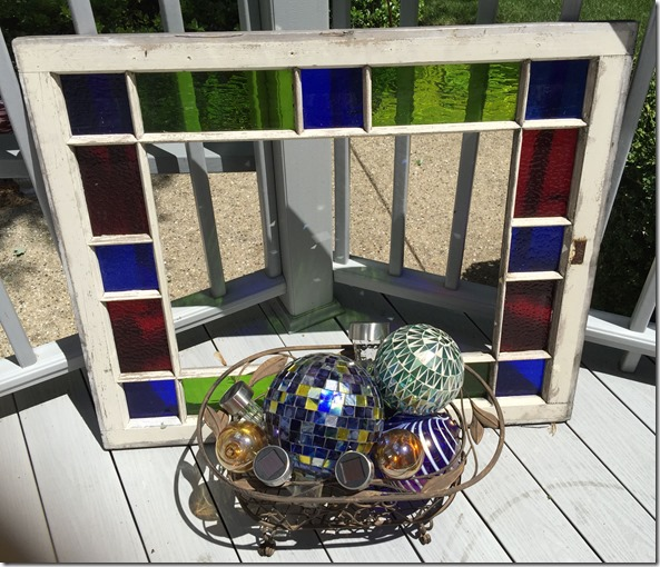 Stain glas window frame with basket of gazing globes