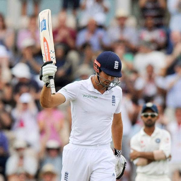 England's Captain Alastair Cook acknowledges the crowd after reaching 50 runs not out during play on the first day of the third cricket Test match between England and India at The Ageas Bowl cricket ground in Southampton on July 27, 2014.