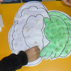 Cauliflower making activity done by sr.kg