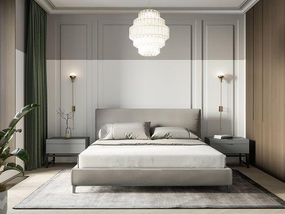 Quarto técnica de pintura meia parede branca e outra cinza, cama com cabeceira estofada cinza, criado mudo cinza e piso em tom neutro