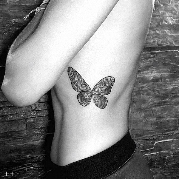 este_redemoinho_de_blackwork_tatuagem_de_borboleta