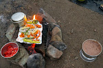 Smokey campfire roasted vegetables with a pot of tortillas keeping warm on the side