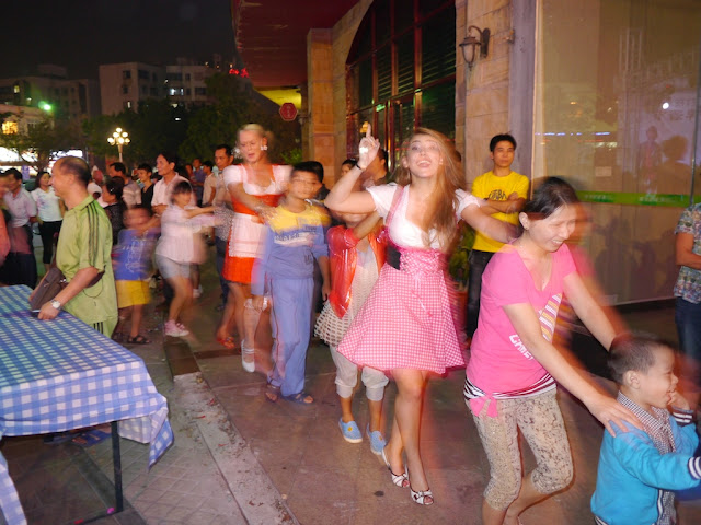 adults and children in a conga line