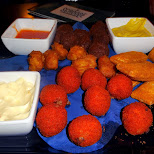 Dutch fried snacks at the stadsschouwberg in Haarlem, Noord Holland, Netherlands