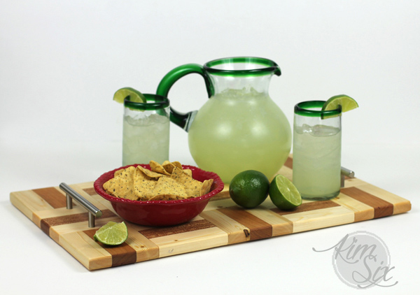 Serving margaritas on wooden tray