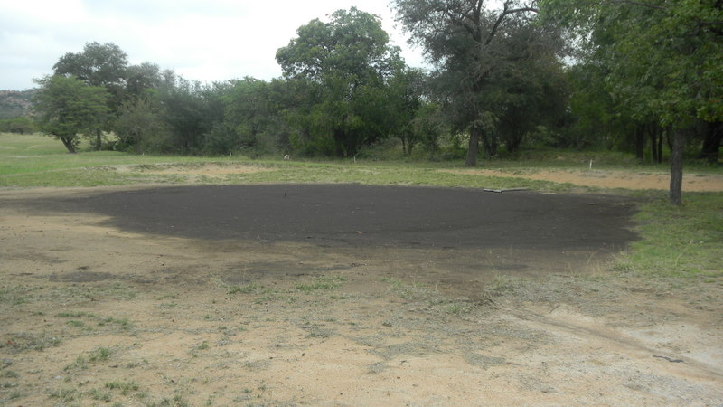 "This brown thing is the ""green"" on a golf course in Botswana"