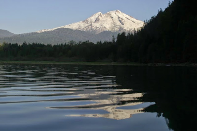 With Mount Baker towering above, Baker Lake is very popular with campers, swimmers, motor boaters, and water-skiers.Credit: Peter James