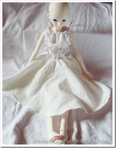 Bjd in an offwhite circle skirt with alternate waistband