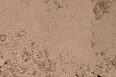 Top Soil - Also known as sandy river loam or river silt. This fine-grained soil is used primarily in other mixes or as a filler for small holes and leveling uneven ground.