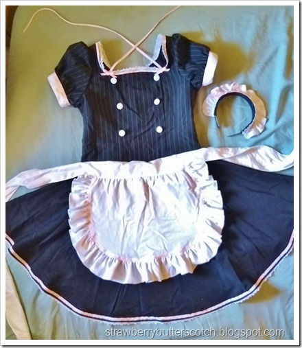The made costume after the makeover.  The collar is gone with a pretty new lace and pink ribbon trimmed neckline.  The headband is now trimmed with ribbon and lace with a matching ribbon bow.  There is lace and pink ribbon along the skirt and more ribbon on the apron.  And no more odd gloves!