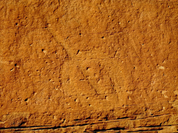 Circle petroglyph with a line through it