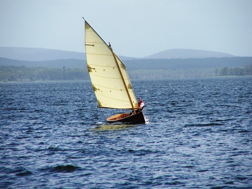 Goat Island Skiff being sailed by Michael Storer.  Paulownia timber means this 16ft hull is 105lbs