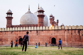 Children play cricket in Lahore along Badshahi Mosque